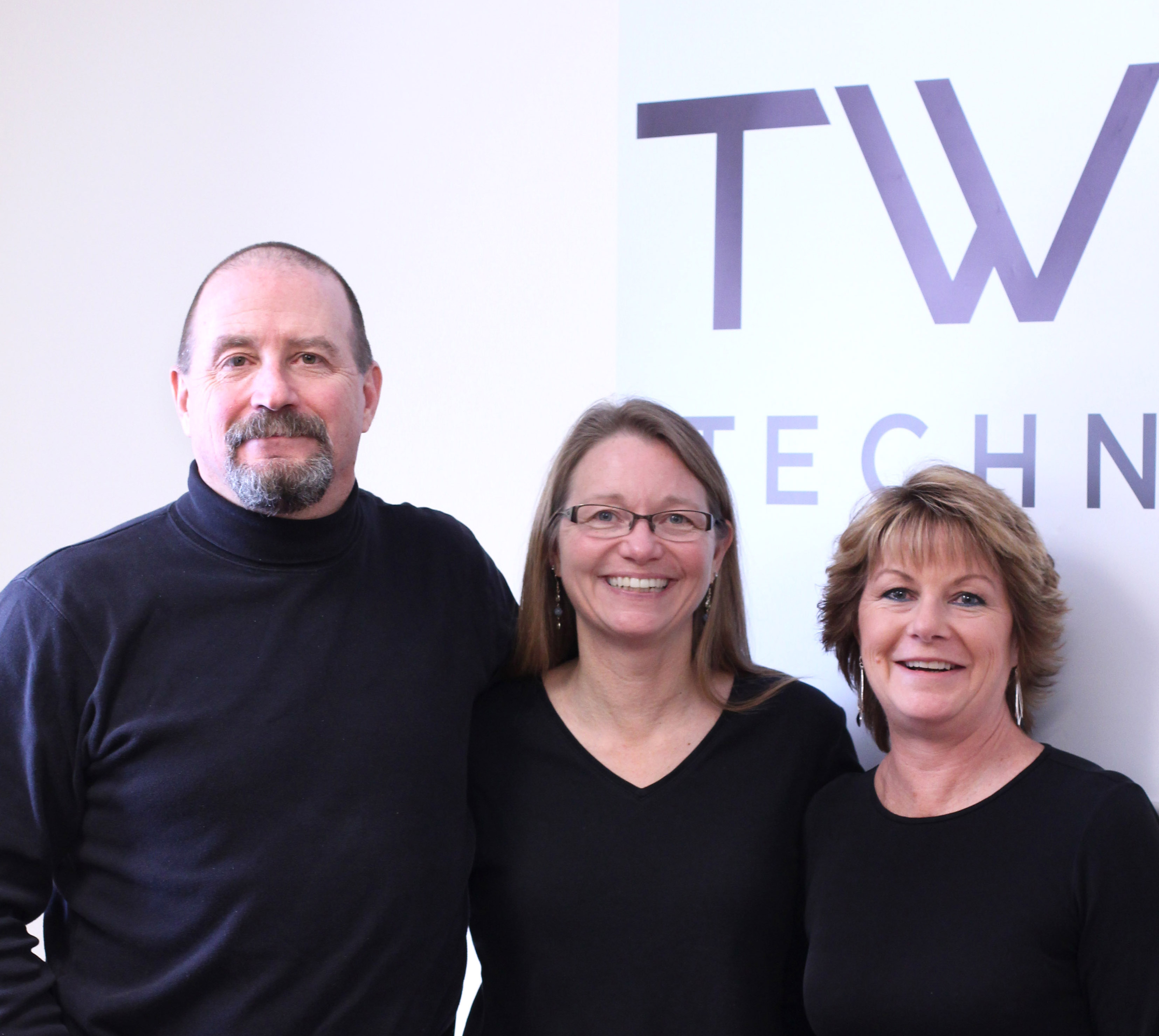 Pictured: Clark Currier, Devi Currier Momot & Dawn Currier Juneau, Owners of Twinstate Technologies
