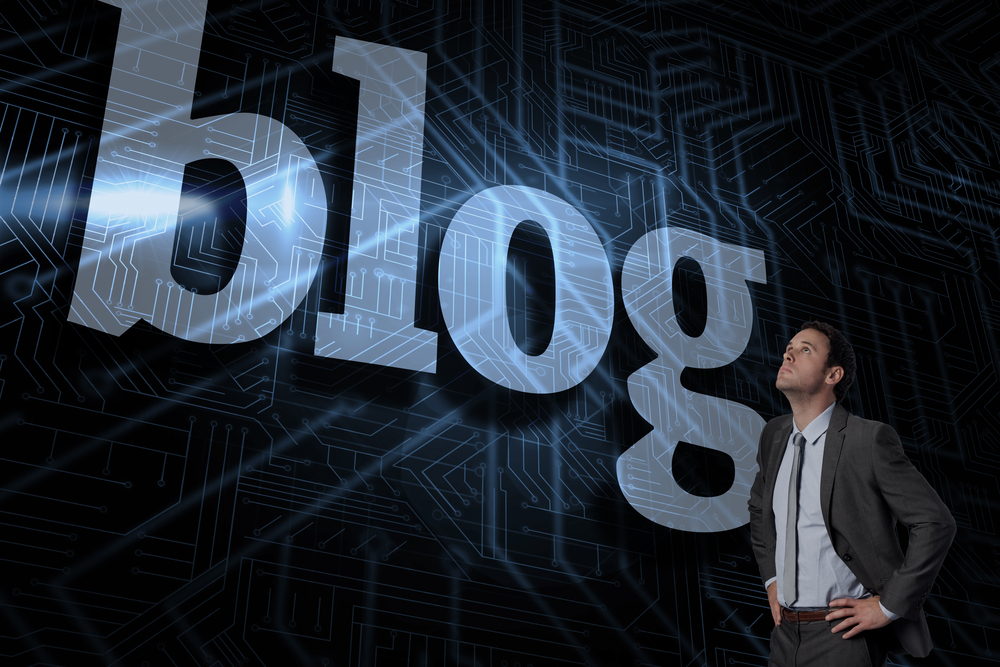 The word blog and serious businessman with hands on hips against futuristic black and blue background