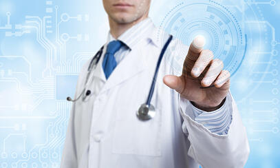 Unrecognizable male doctor with stethoscope working with virtual screen panel