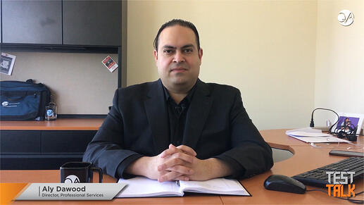 Man in dark suit at desk - Aly Dawood - QA Consultants Accessibility services