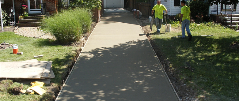Sleek Traditional Concrete Driveways and Sidewalks