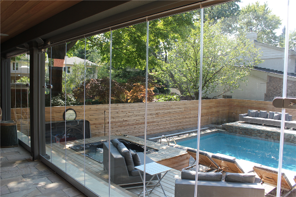 Panoramic Patio Enclosure. Sliding tempered glass panels creates a year round retreat