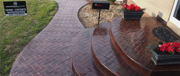 Brick Pattern Steps & Walkway added on to a Driveway in the Color Red Located in Willowick Ohio