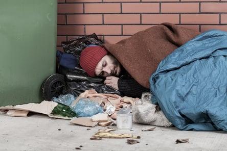 Poor man sleeping on the street, horizontal.jpeg