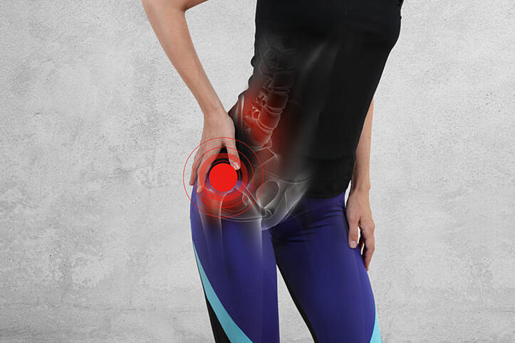 Woman with hip joint pain