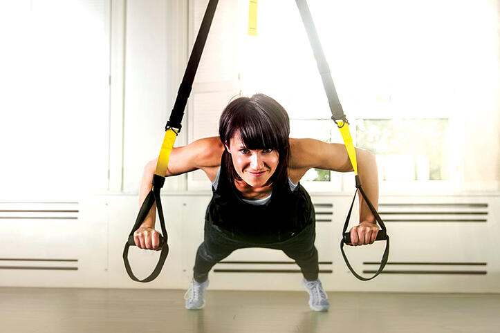 Woman using TRX