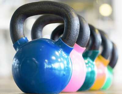 kettlebells lined up in a gym