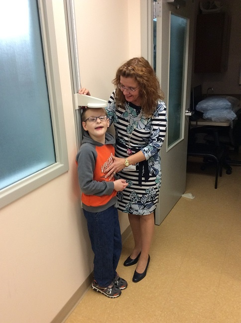 Tammy with Caleb at Treffert Clinic.jpg