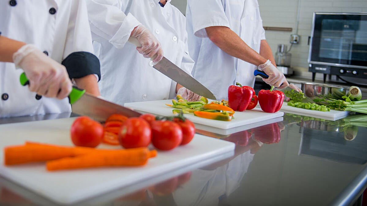 students cutting vegetables in a lab