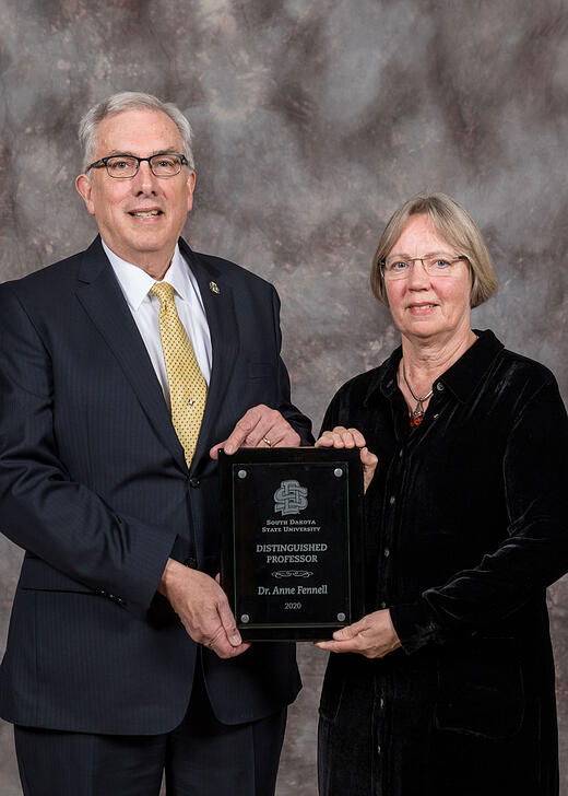 President Barry Dunn presented distinguished professor award to Anne Fennell