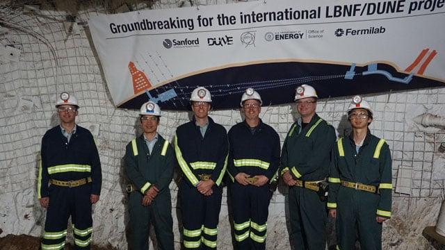 SDSU engineering professors standing in Sanford Underground Research Laboratory