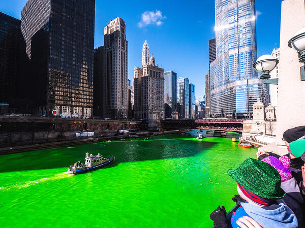 Photo of people celebrating the Dyed green river in Chicago in honor of St. Patrick's day