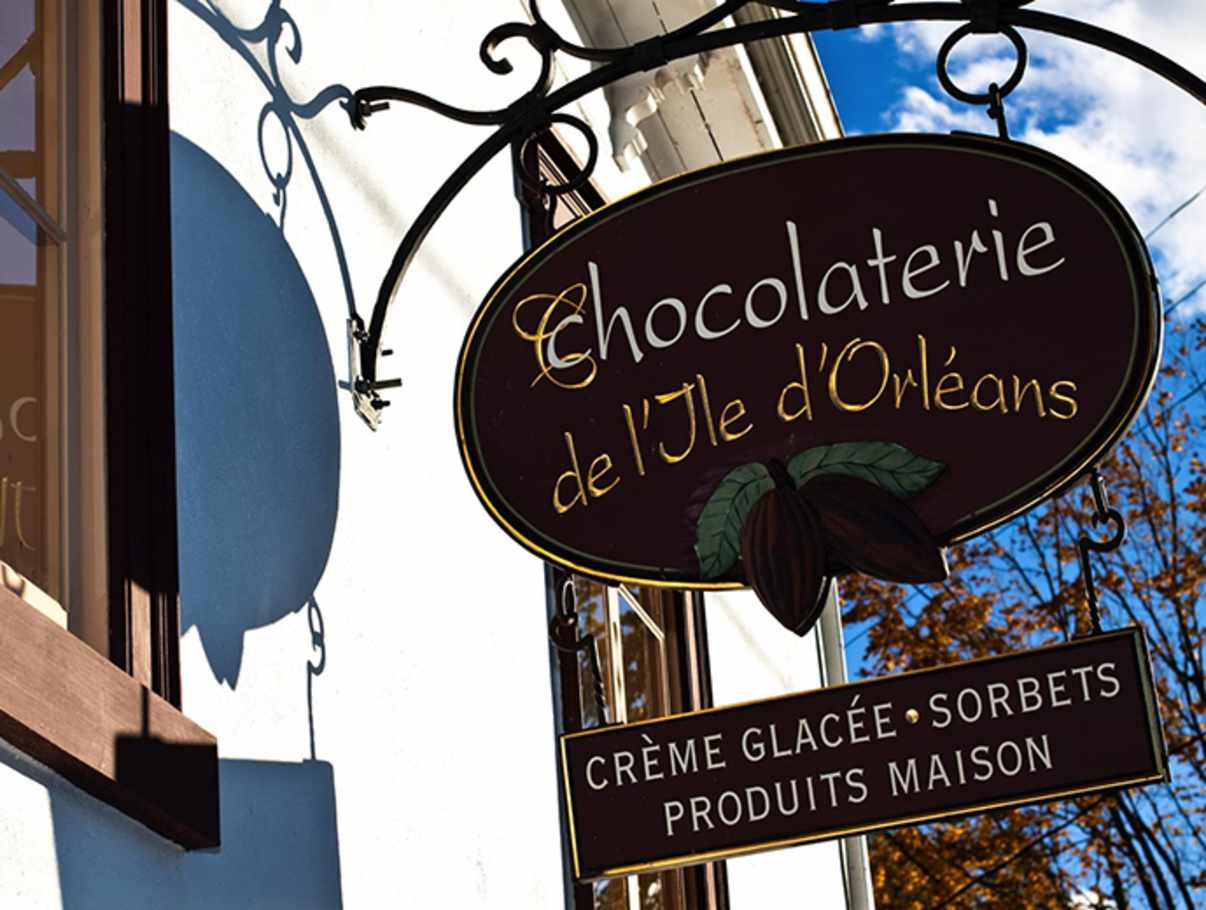 A beautiful view of the sign outside Chocolaterie de l'Jle d'Orleans in Quebec City.