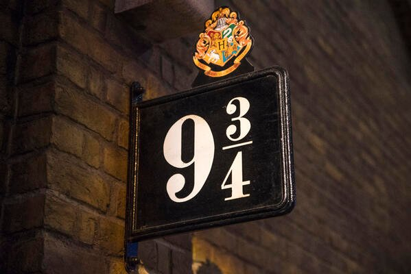 It's a brown 9 3/4 train platform sign on a brick wall from Harry Potter.