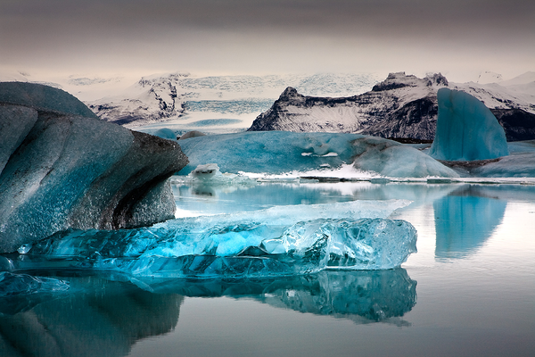 Bright blue icebergs are floating in the clear waters in Jökulsárlón.