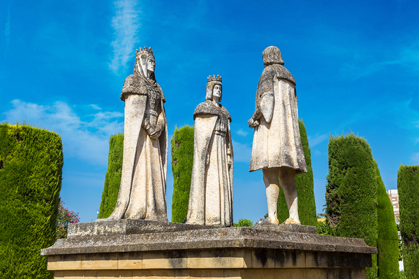 The statues at Alcazar in Cordoba, Spain, of three figures including the Queen Isabella, King Ferdinand, and Christopher Columbus.