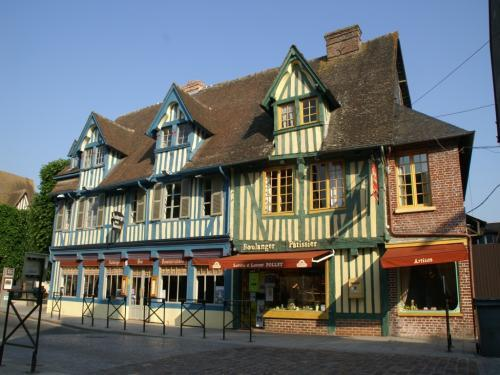 A wide angled shot of the building in France where Pont-l'Eveque is located.