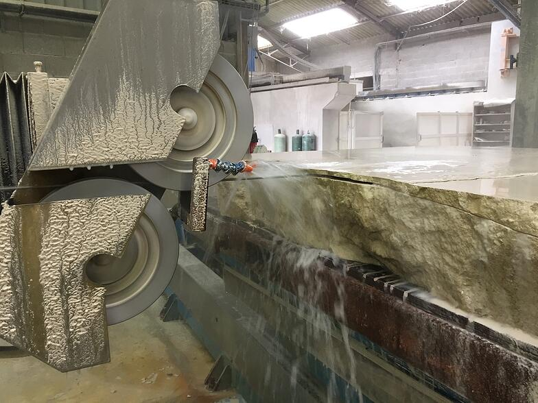 CNC wire saw cutting French limestone curved slabs