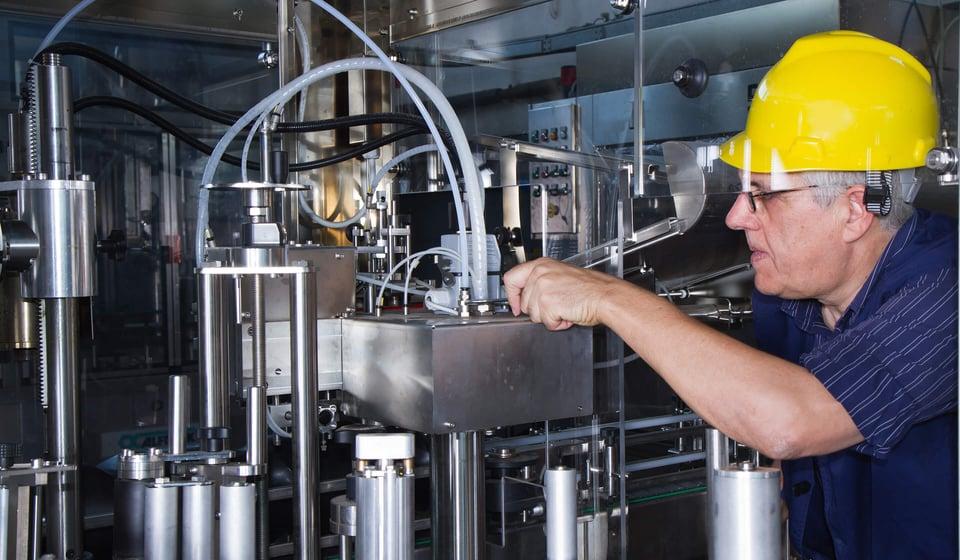 engineer maintaining machinery