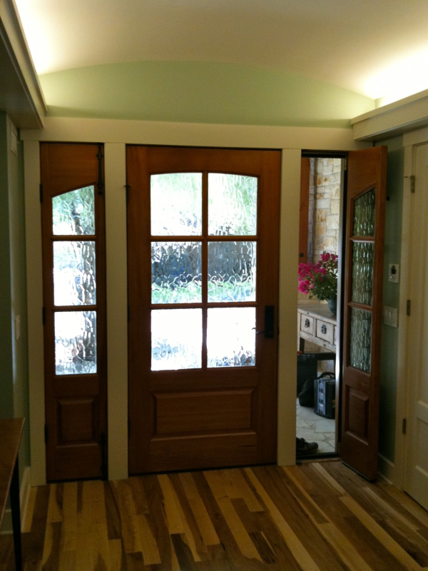 front door has operable sidelights with screen to allow breezes while