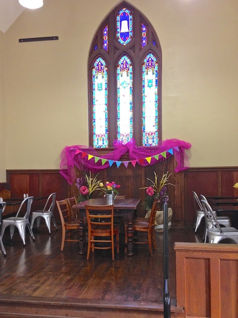 Adaptive-Reuse-Church-to-Bakery-under_stained_glass