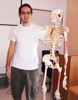 Dr. Adrian Garcia, medical student at Trinity SoM with Mr. Bones