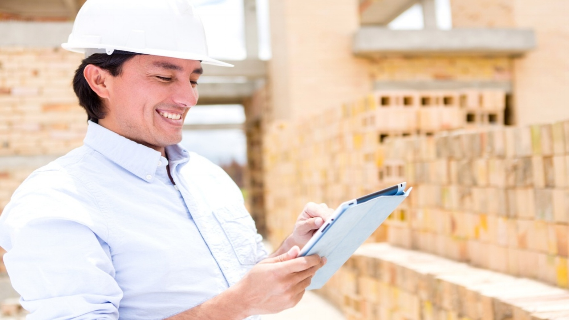 Civil engineer working with a tablet computer-887316-edited.jpeg