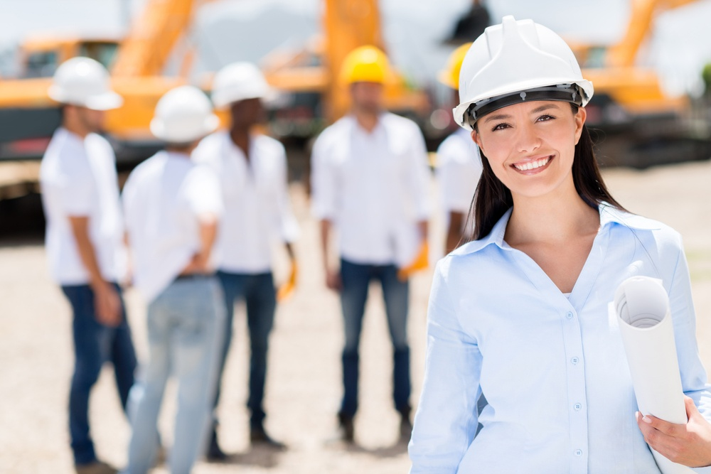 Female architect at a construction site looking happy.jpeg