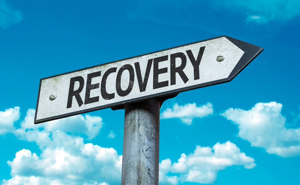 Recovery sign with sky background.jpeg