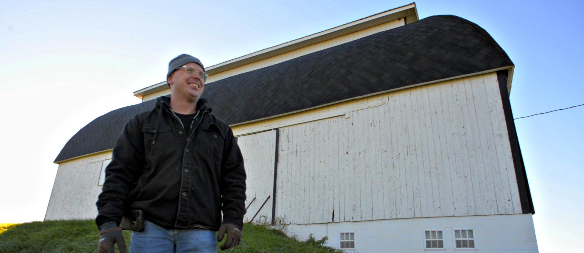 jimmy-barnwood-hovey-in-front-of-barn.jpg