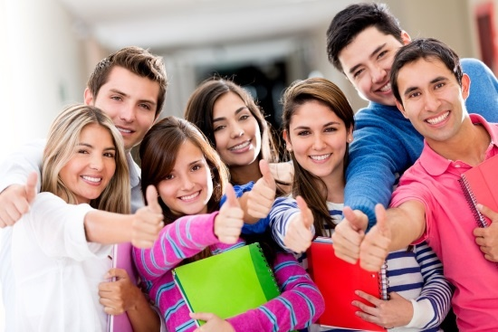 Happy group of students with thumbs up_550