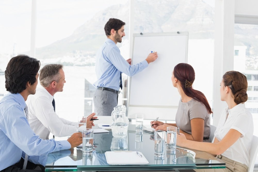 Business man giving a presentation to his team-1