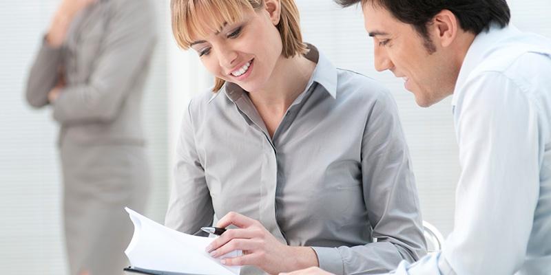 people looking at customer feedback reports
