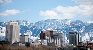 salt-lake-city-utah-winter-skyline-with-snow-covered-mountains-picture-id160735798
