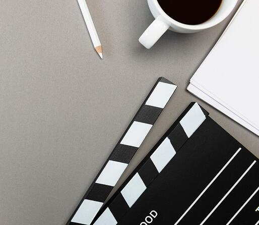 Video Clapboard, Coffee and Pencil Lying on a Table