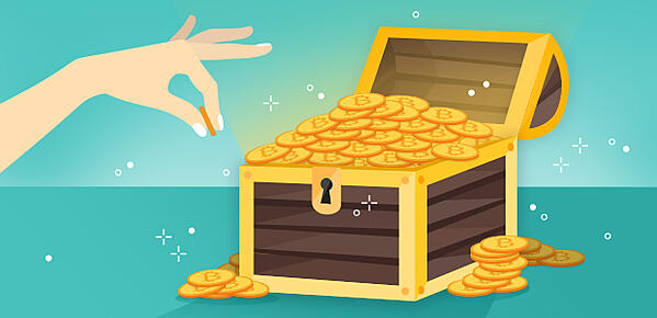 A hand having pulled a bitcoin out of a treasure chest