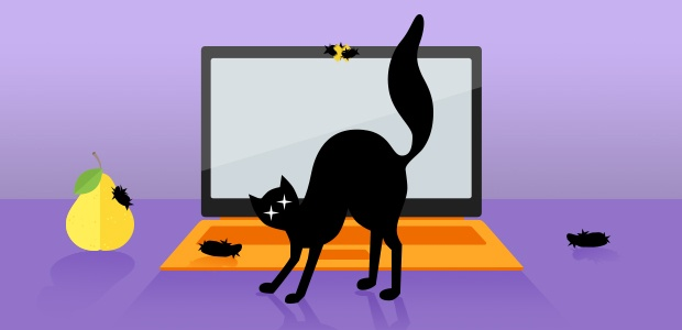Black cat arching its back in front of a laptop with hairballs on the webcam and keyboard.
