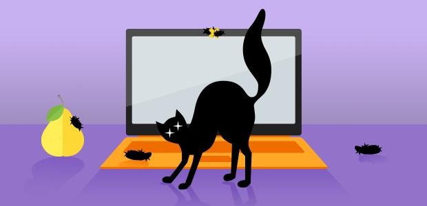 Schwarzer Kater, die einen Buckel macht, vor einem Laptop mit Fellbüscheln auf Webcam und Tastatur.