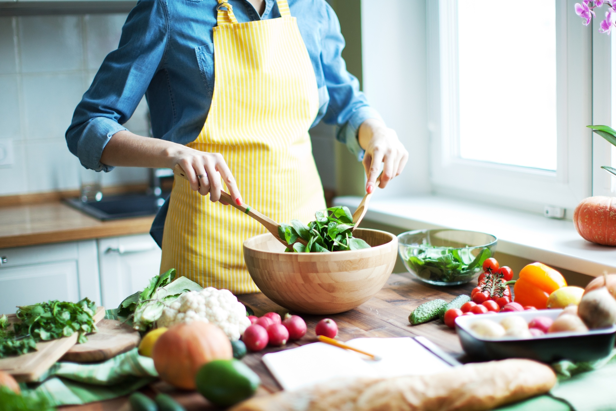 A woman preparing a healthy salad