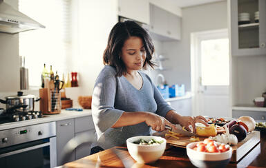 A woman preparing a healthy meal