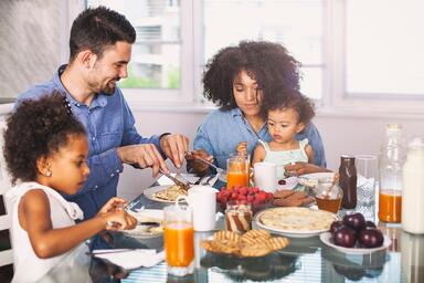 Mom and family eating together with baby