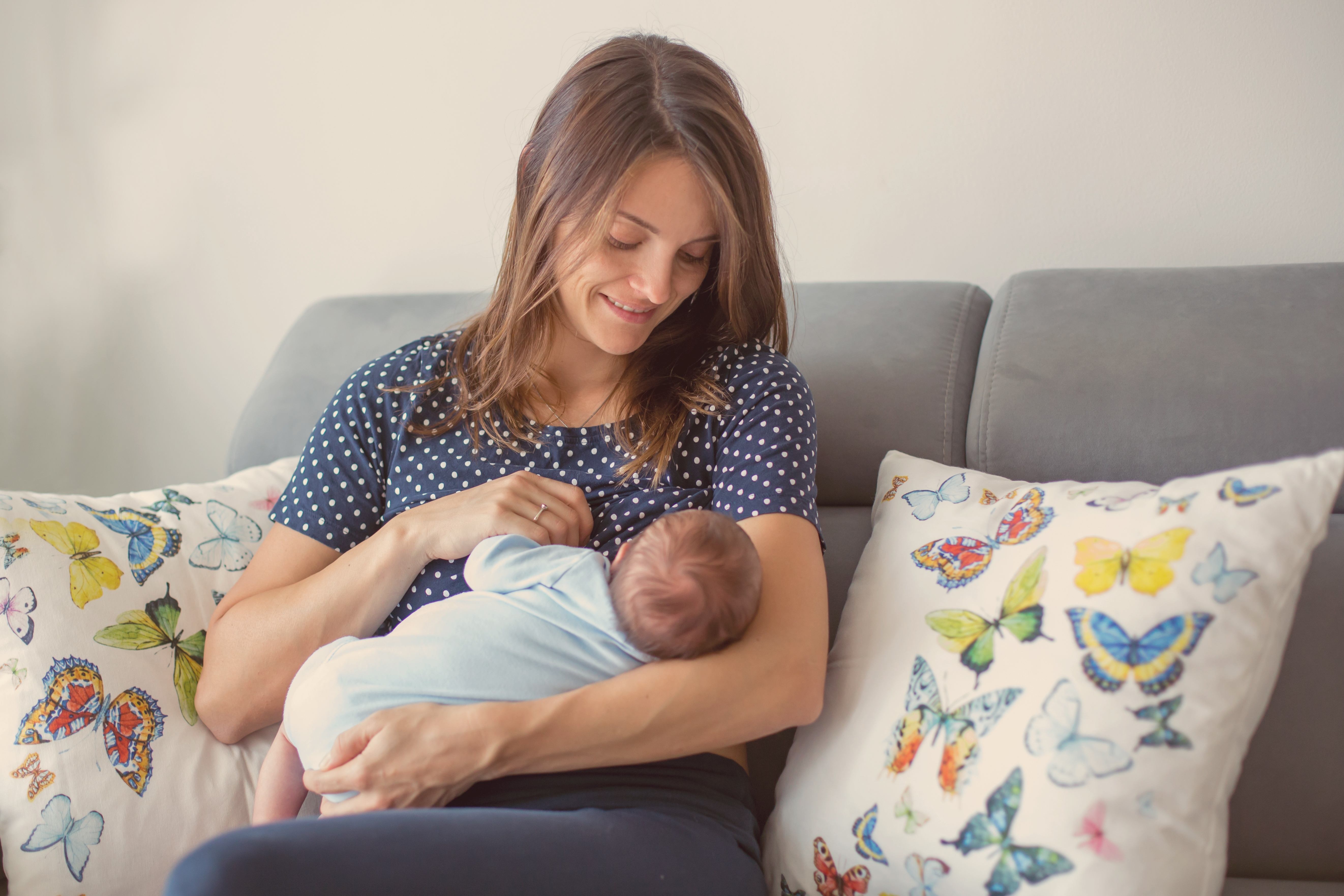A mom preparing to breastfeed