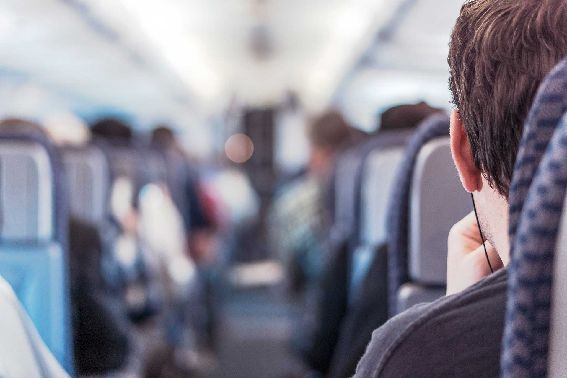 Man with headphones on a plane