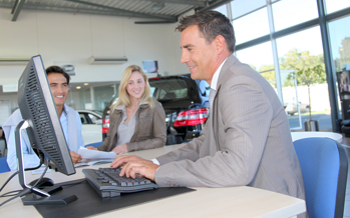 Car Dealer At Computer-3