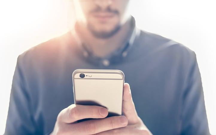 businessman_using_iphone.jpg