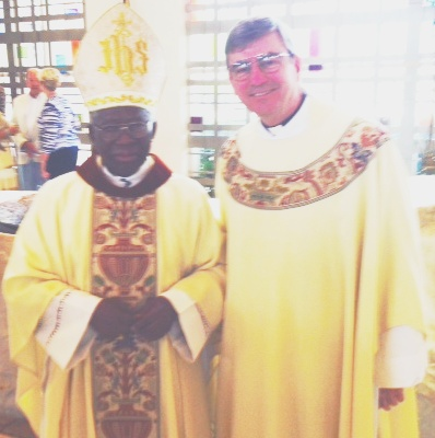 Cardinal Francis Arinze and Father John Phalen, CSC, concelebrate mass in Florida.
