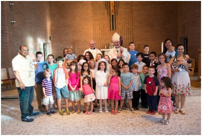 Bishop Edgar da Cunha, SDV, Father Willy Raymond, CSC, and young guests at Father Peyton's anniversary celebration, June 6, 2015