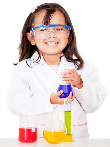 Girl doing chemical experiments at the lab