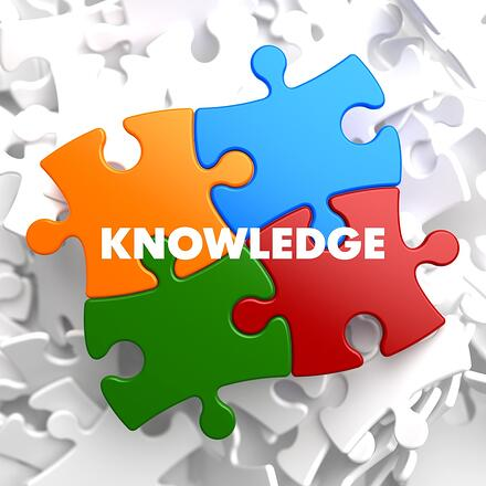 Knowledge on Multicolor Puzzle on White Background..jpeg