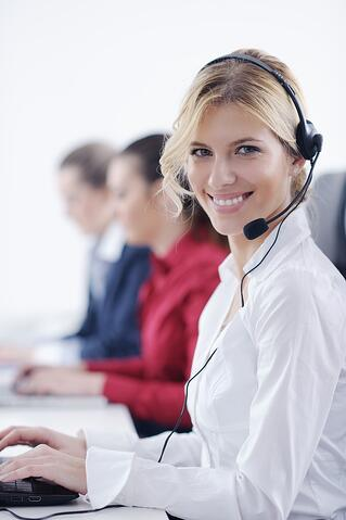 Woman with headphones smiling at you against white background